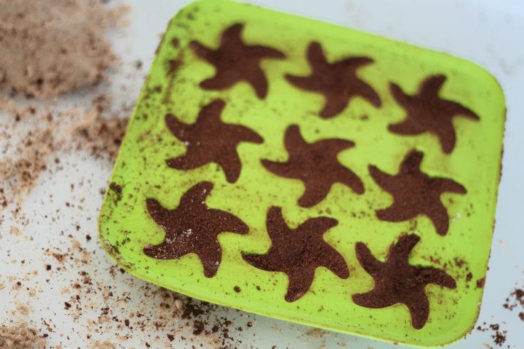 ikea silicone ice cube tray is great for cloud dough play - making star shapes