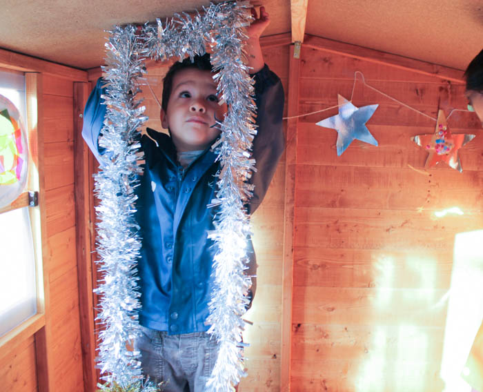 decorating wooden playhouse into a winter grotto