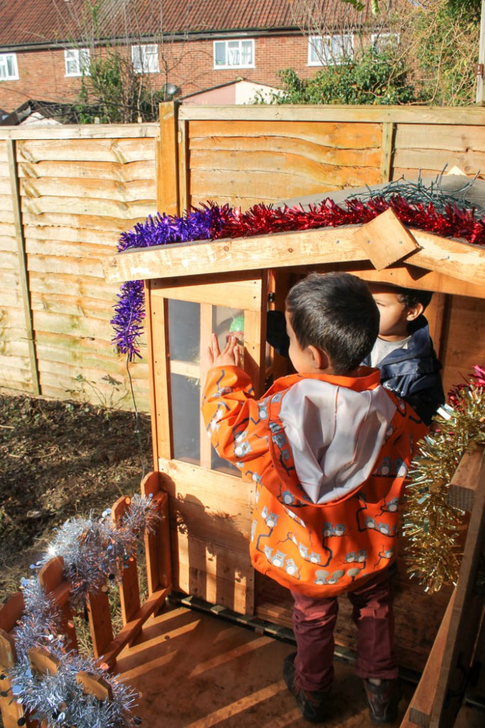 wooden playhouse turned into a winter grotto
