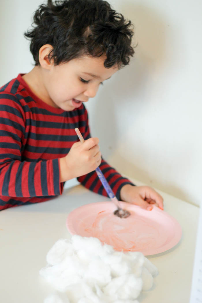 using a paint brush to spread glue