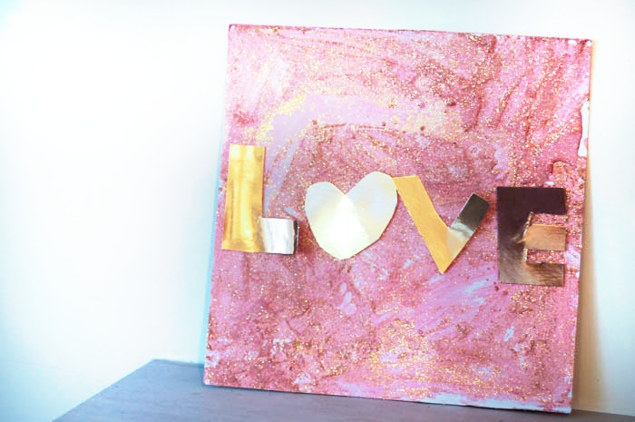 "Kid made process art for Valentines day textured ""love"" canvas"