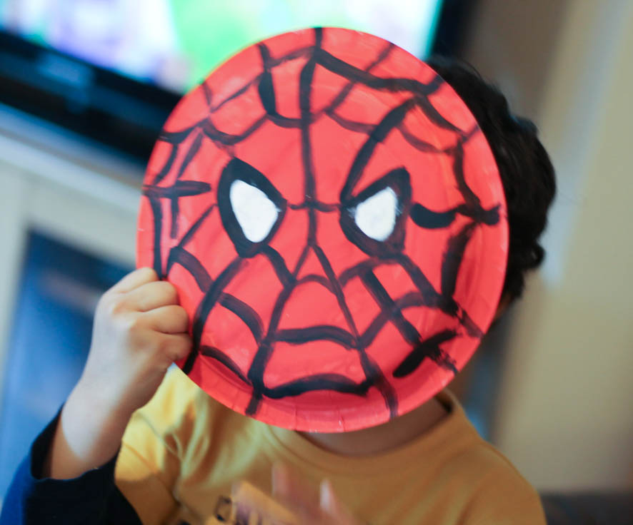 Paper plate Spider-Man face as a mask