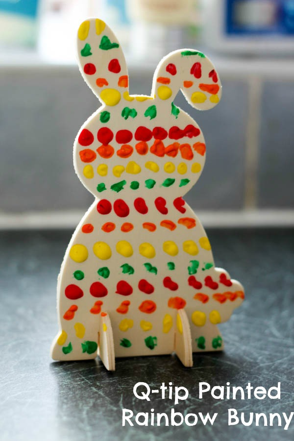 cotton bud or q tip painting on a vertical surface for fine motor practice. Make these rainbow bunnies for spring