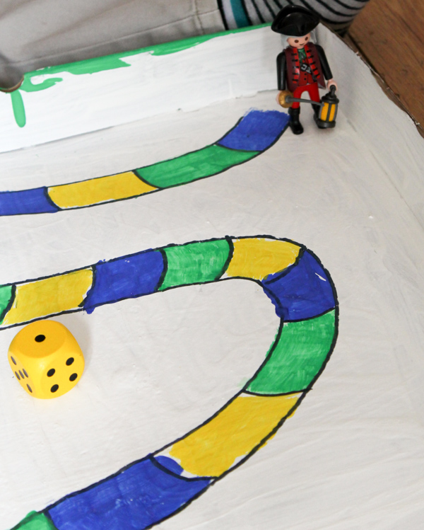 diy board game made from a cardboard pizza box and playmobil