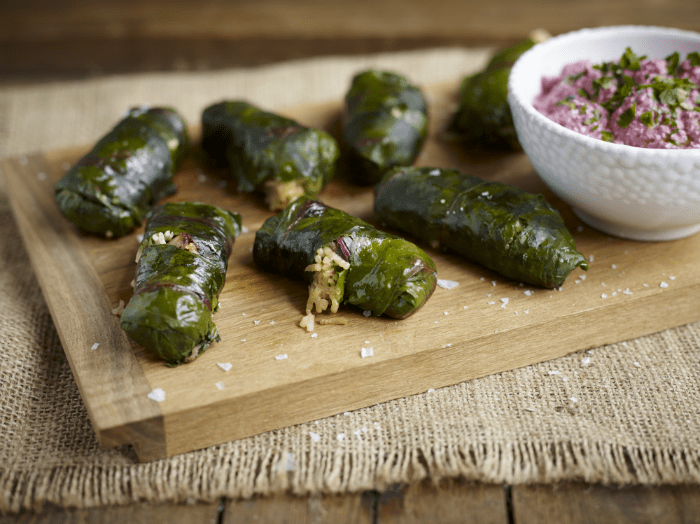 Beat leaf dolmades stuffed with rice and beetroot and walnut tzatziki