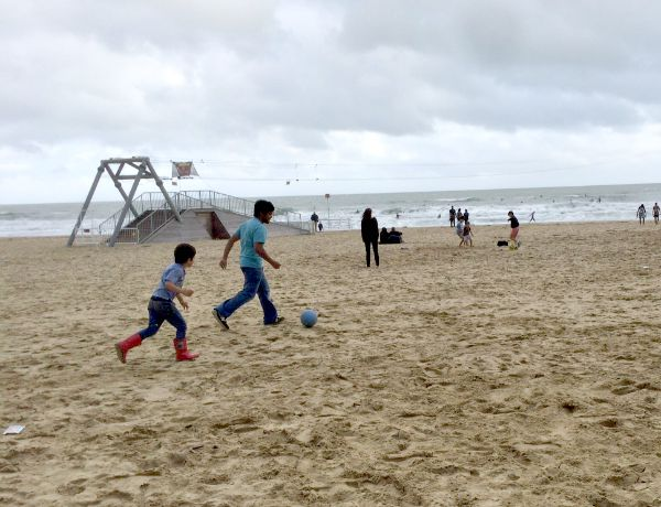 Playing football on the beach in bournemouth