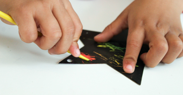 Outer space scratch art craft for kids. Great for a solar system topic, or a space birthday party
