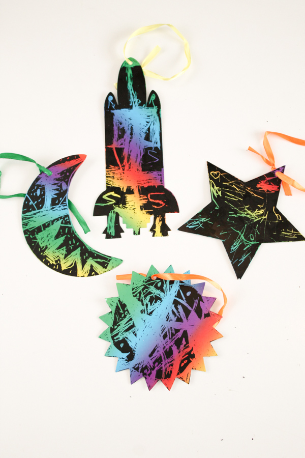 Colourful outer space scratch art craft for kids. Great for a solar system topic, or a space birthday party
