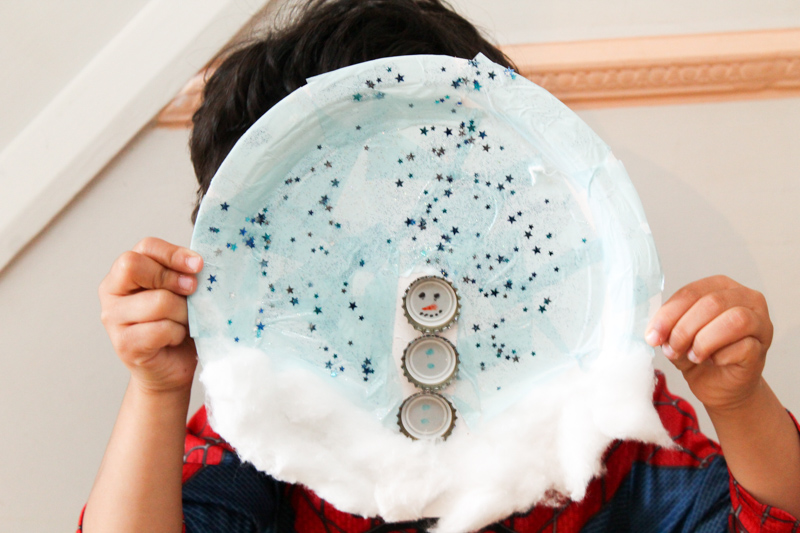 paper plate snowman winter craft for kids using recycled bottle tops