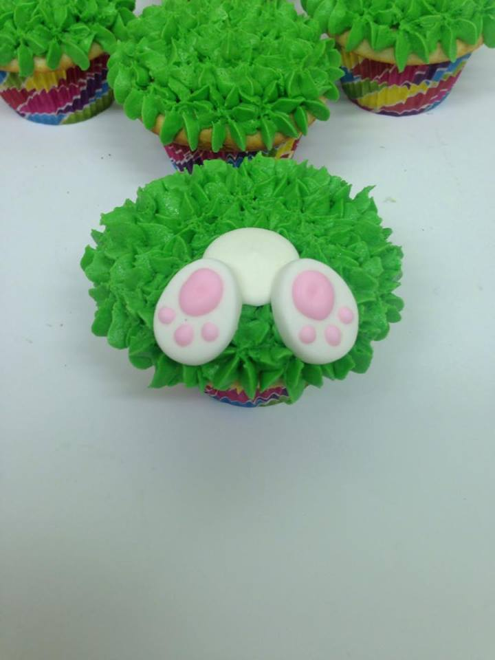 super cute easter bunny cupcakes with bunny tails and easter eggs