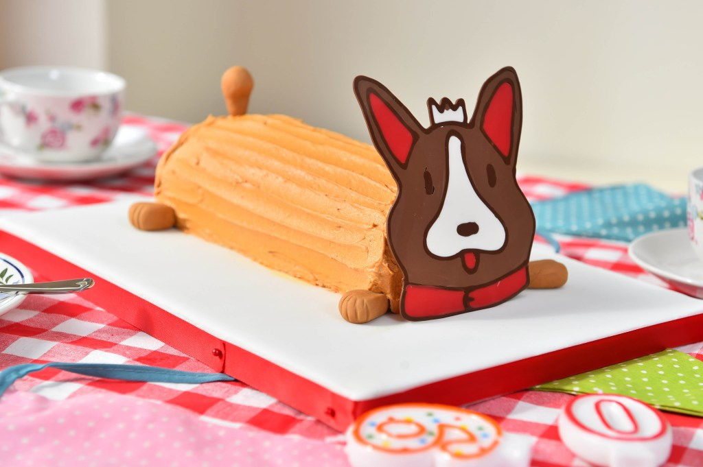 EMBARGOED TO 0001 MONDAY APRIL 18 EDITORIAL USE ONLY Edd Kimber, winner of the BBC's Great British Bake Off, creates ÔCandy the CorgiÕ birthday cake using Stork with Butter to celebrate Queen Elizabeth IIÕs 90th birthday. PRESS ASSOCIATION Photo. Issue date: Sunday April 17, 2016. The corgi cake is a reimagined version of BritainÕs favourite birthday cake, the chocolate caterpillar and honours the QueenÕs favourite pet dog. Photo credit should read: Matt Crossick/PA Wire