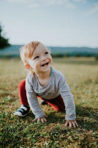 autumn baby boy crawling