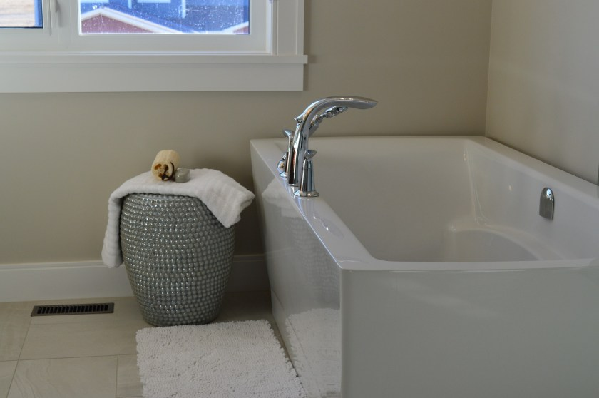 bathroom with bath mat