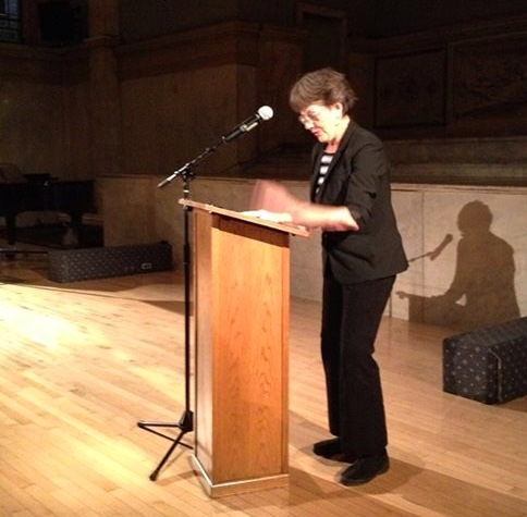 Deborah Lawlor reads a poem at the Freddy conference.