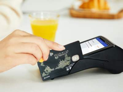 A hand swiping a credit card.