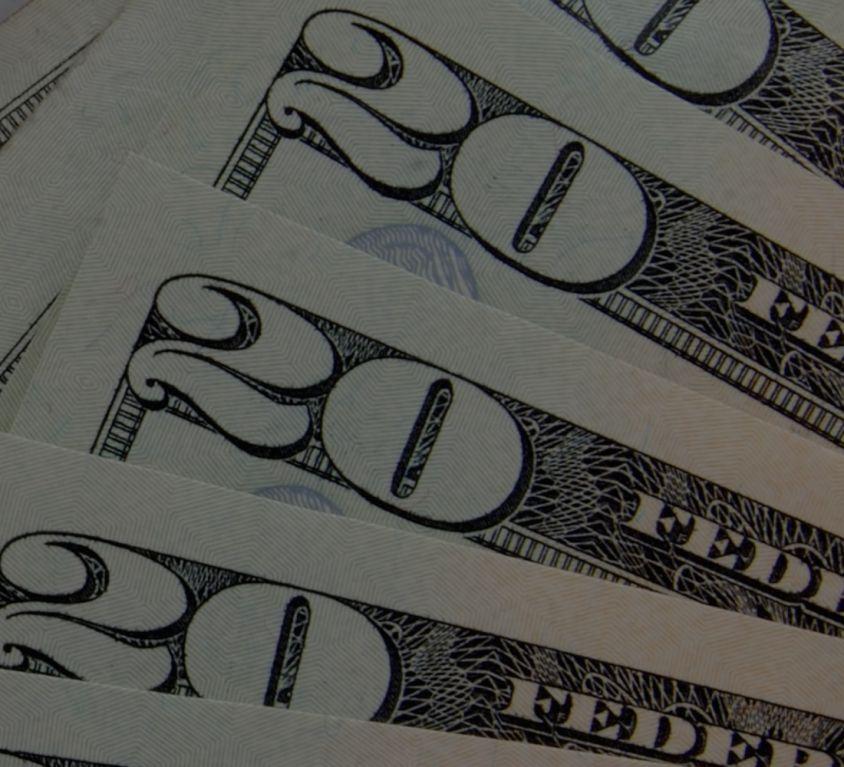 A stack of 20 dollar bills