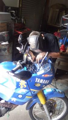 Steve at Moab 4x4 Outpost, welding the fairing back on.