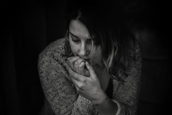 Impacts of COVID on mental health: image of a woman looking sad