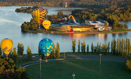 Hot air balloons over Lake Burley Griffin and the National Museum of Australia