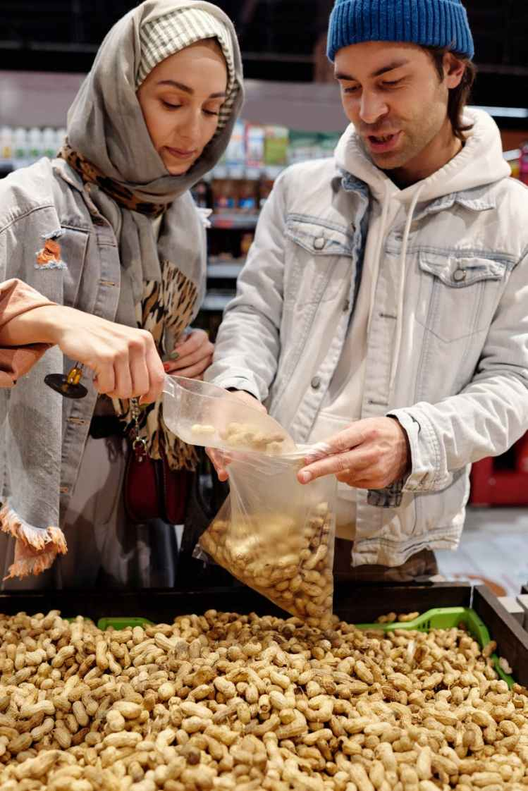 couple buying peanuts