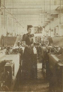 (image courtesy of Manchester Historic Association) | Louisa Lessard working at a loom