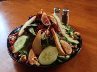 Waterworks Cafe - Fig & Roasted Pear Salad w fresh black mission figs, roasted pears, dried cranberries, candied walnuts and cucumbers over mixed greens and spinach, topped with raspberry balsamic vinaigrette