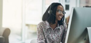 Smiling woman using contact center software