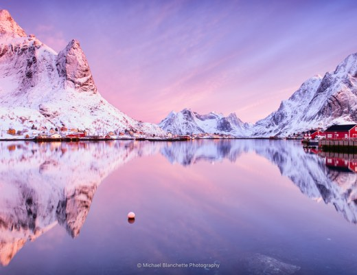 Reine is a beautiful Norwegian fishing village in the Lofoten archipelago. The small village sits on Reinefjord, which has been voted one of the most beautiful places in Norway. This image was made at sunrise on March as the sun hit the mountain peaks.
