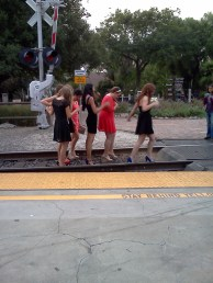 Idiot girls posing on the tracks as parents looked on.
