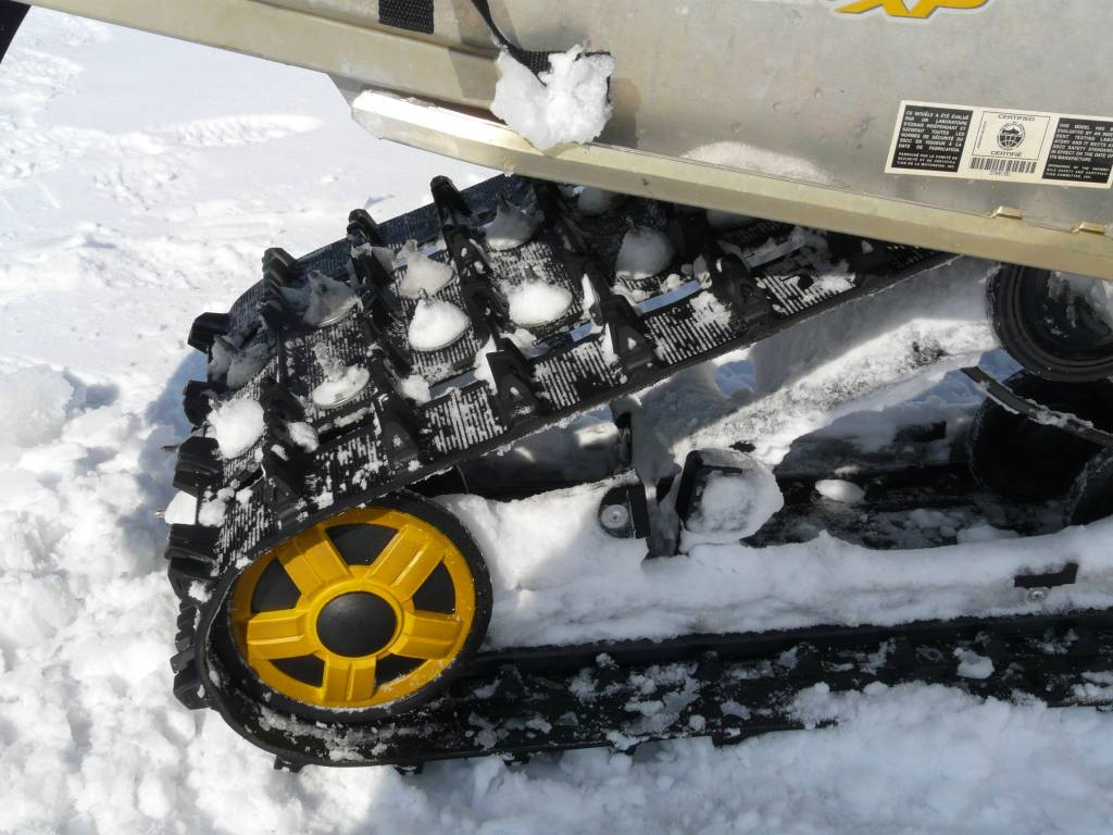 reduce snowmobiling risks with Woody's studs