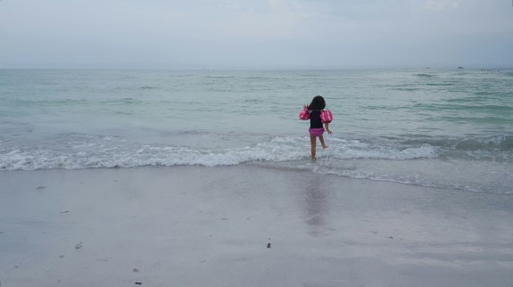 Prancing into the Siesta Key waters.