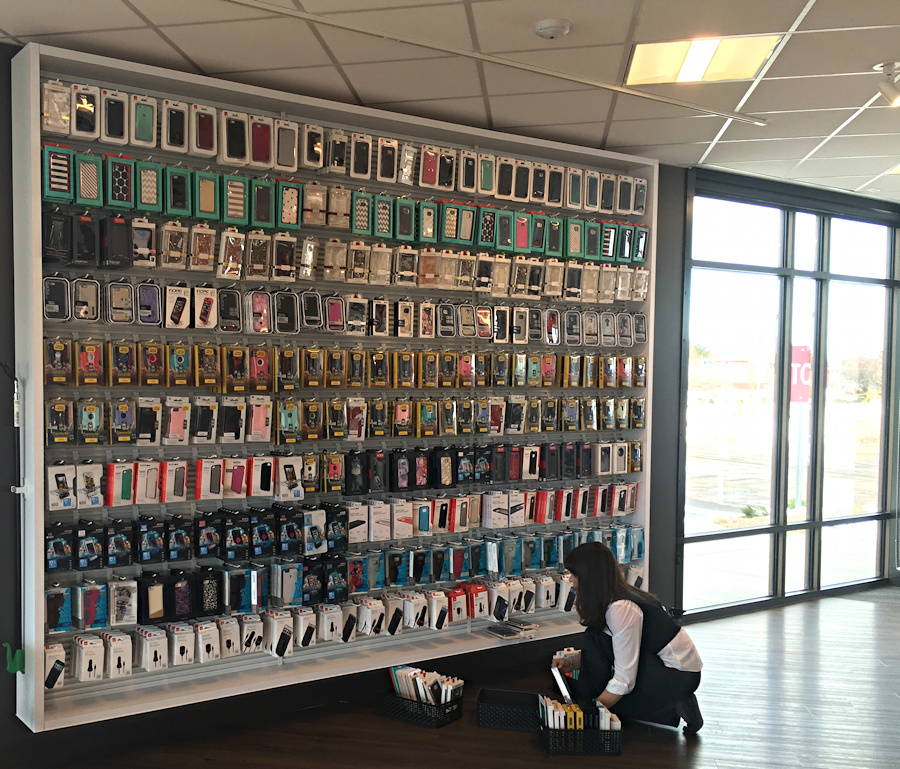 verizon store wall of smartphone iphone android cases