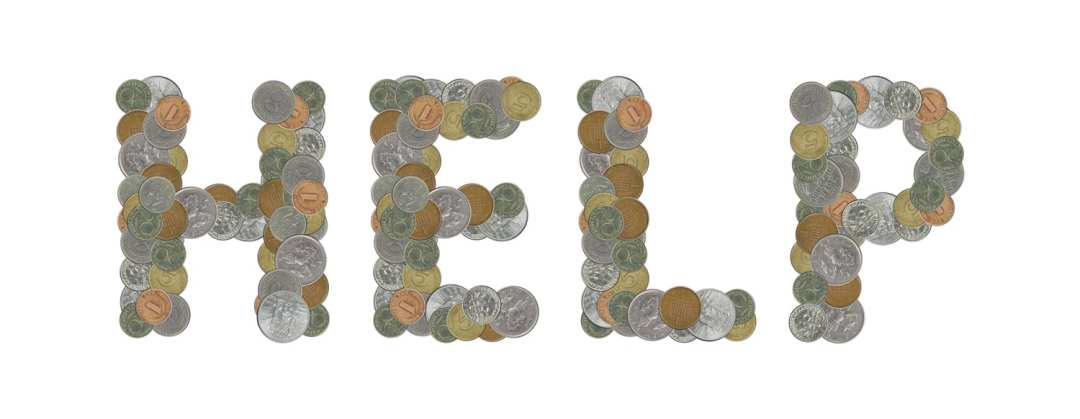 The word HELP spelled with coins