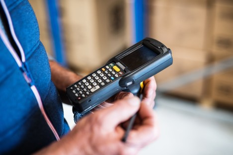 Warehouse scanner, industrial handheld device, mobile operated, scanning, barcode reader