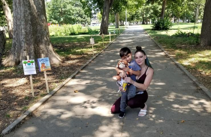 Mother and sun attend a StoryWalk in Philadelphia park