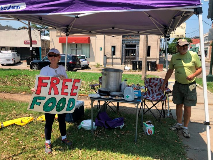Joyce and Dave Thomas offer free jambalaya, cooked up by one of their neighbors in New Orleans after Hurricane Ida hit and left much of the city without power.