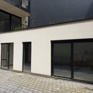 Investment-Assist_Qstay_Antwerpen_investeringsvastgoed_3%_jaarlijks_rendement_binnentuin