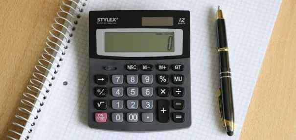 calculator with pen and paper
