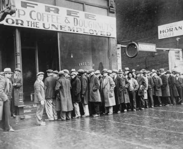 unemployed men standing outside a soup kitchen during the depression