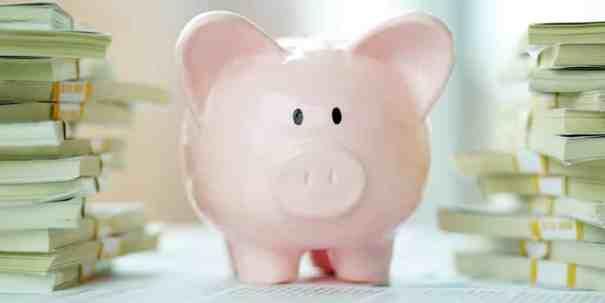 piggy bank cash stacks