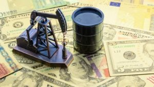 Miniature Oil Barrel and Oil Well Figures on Top of Money Stack