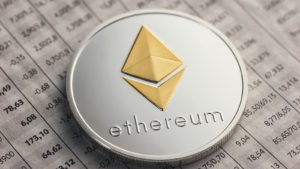 A coin with the Ethreum logo on top of a financial document