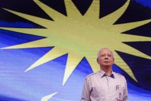 Najib Razak standing