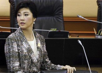 Former Thai PM ordered to repay $8.1 billion for failed rice scheme