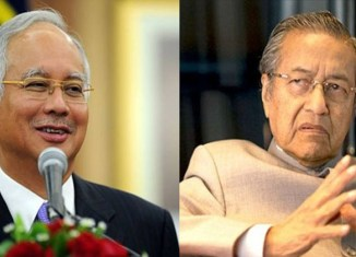 Malaysia's opposition weakened as Najib's ruling coalition wins by-elections