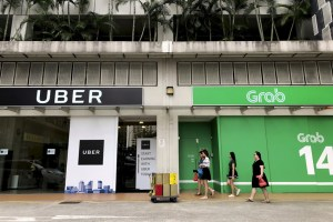 Uber retreats from Southeast Asian market, sells to Grab