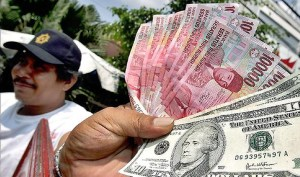 """Indonesian businesses asked to start hedging """"beyond usual"""" as rupiah tumbles"""