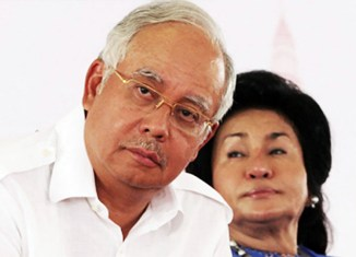 Malaysia ex-PM banned from leaving country – quits as party head