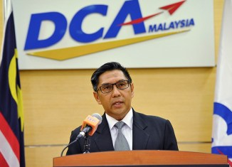 Malaysia's aviation chief quits after MH370 report exposes shortcomings