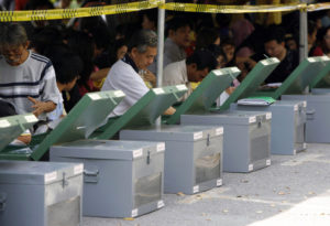 Thailand lifts political campaign ban and sets election date for February 24
